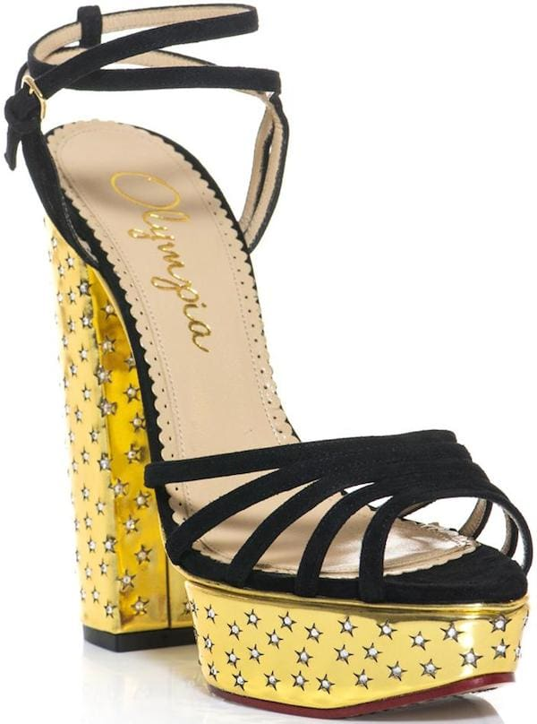 Rising Star sandals with black suede straps and metallic gold heels and platforms