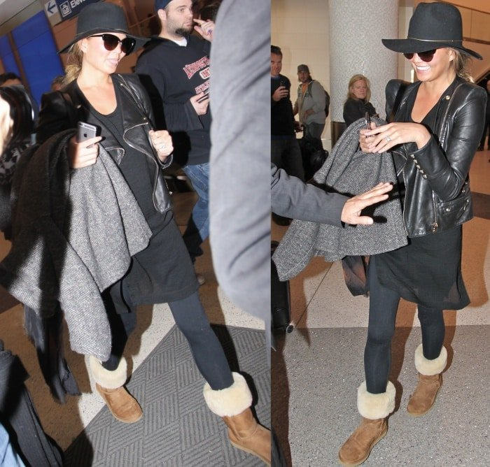 Chrissy Teigen wearing Ugg boots with jeans
