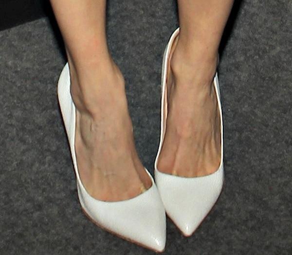 Emmy Rossum's white pumps from Rupert Sanderson