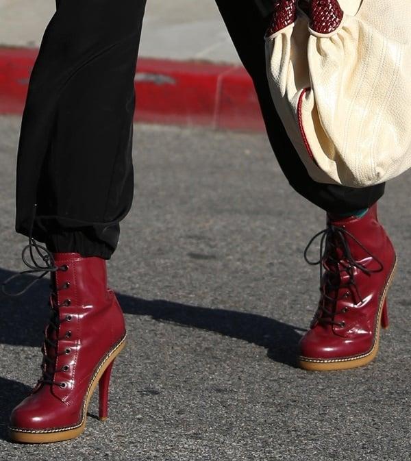 "Gwen Stefani wears a pair of lace-up heeled ""Nichol"" booties"