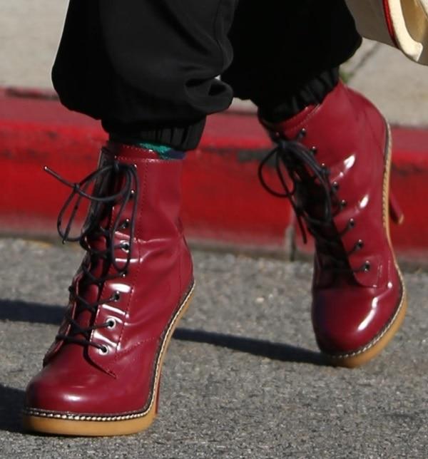 Gwen Stefani rocks a red pair of L.A.M.B. booties