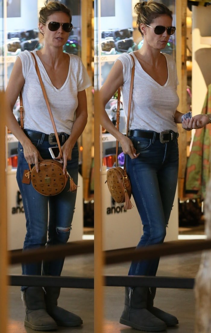 Heidi Klum shopping in grey UGG Classic Short boots and Amo Babe high rise crop jeans in Beverly Hills