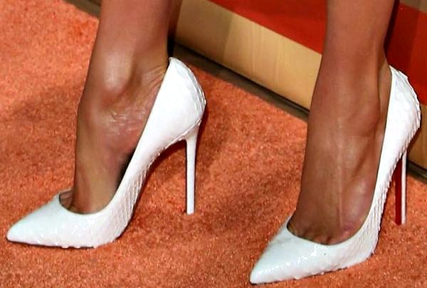 """Jennifer Lopez wore the """"Pigalle"""" python pumps in white from Christian Louboutin"""