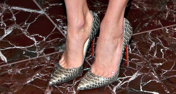 "Karlie Kloss wearing ""So Kate"" python pumps from Christian Louboutin"