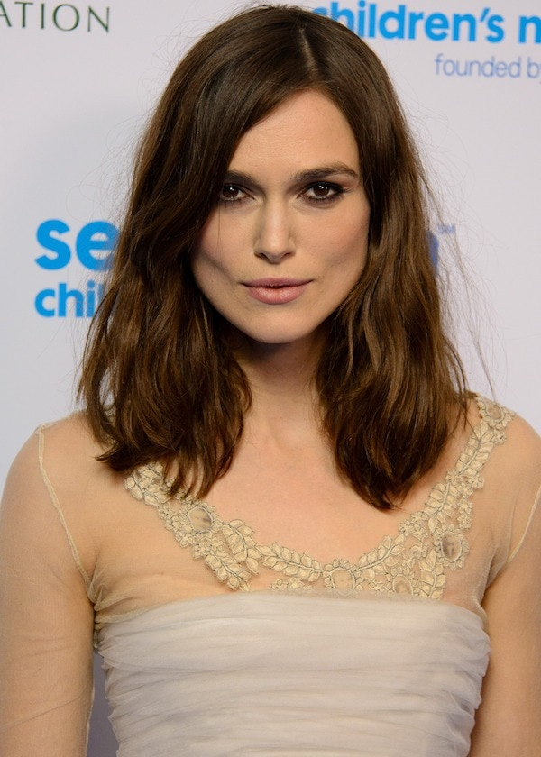 Keira Knightley's hair fell in soft waves around her shoulders