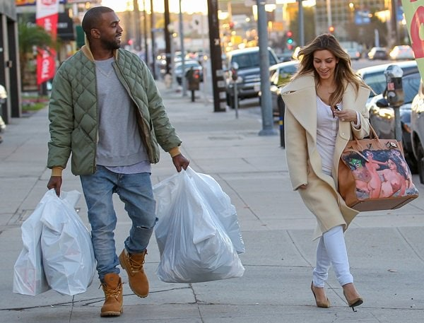 Kim Kardashian showing off her Christmas gift from her fiance, Kanye West, while shopping in Los Angeles on December 26, 2013
