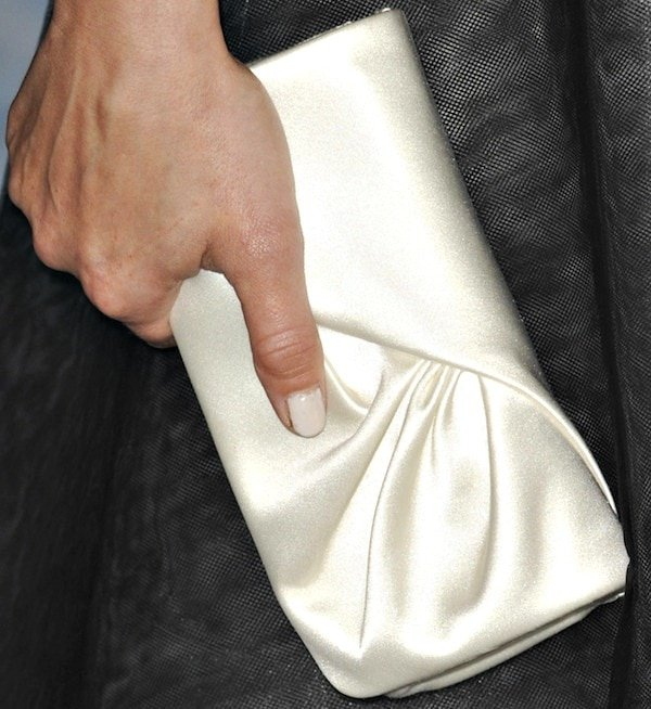 Kristen Bell toting a white satin clutch from Christian Louboutin