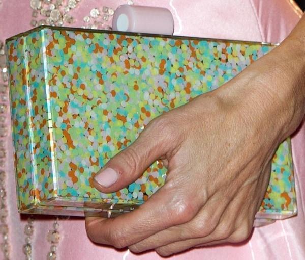 Laura Baileytoting amulticolored polka dot clutch