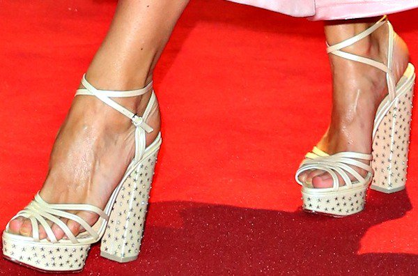 Laura Baileywearingstrappy platform sandals from Charlotte Olympia