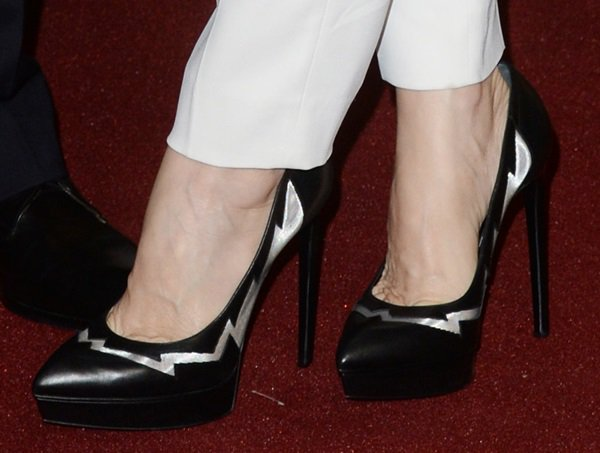 "The black pumps are a variation of the popular ""Janis"" we've seen on quite a number of celebs"
