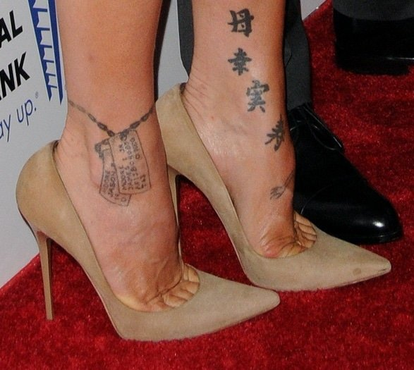 Pink's feet in sky-high nude pumps from Jimmy Choo