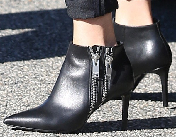 Reese Witherspoon in black leather ankle booties from Saint Laurent
