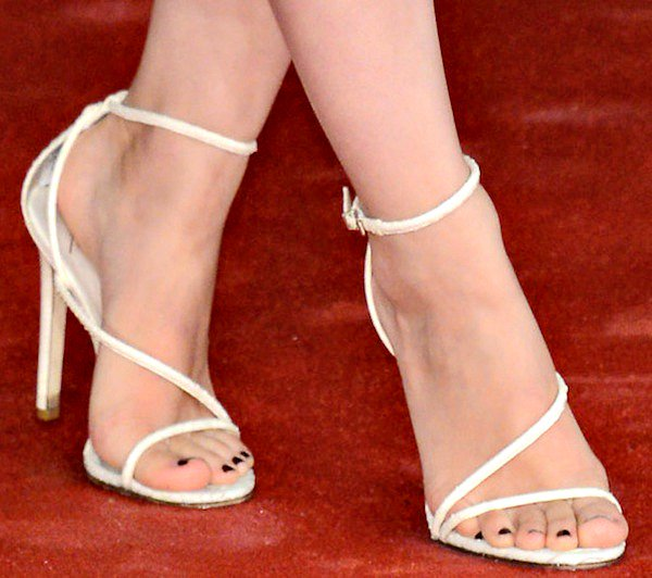 "Rooney Mara in white ""Labrea"" snakeskin sandals from B Brian Atwood"