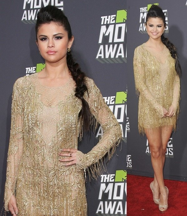 Selena Gomez wearing a gold Julien Macdonald dress and glittered Jimmy Choo peep-toe pumps at the 2013 MTV Movie Awards in Los Angeles on April 14, 2013