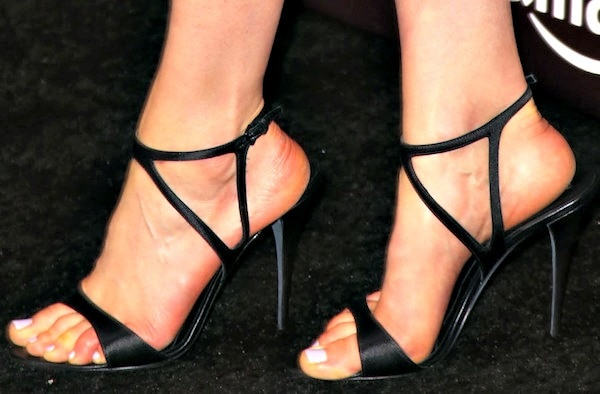 Taylor Schilling in black satin sandals from Narciso Rodriguez