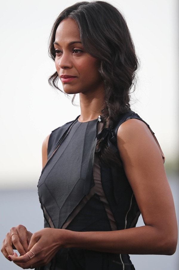 Zoe Saldana's hair fell in soft waves and was swept to one side in a loose braid tied with a ribbon