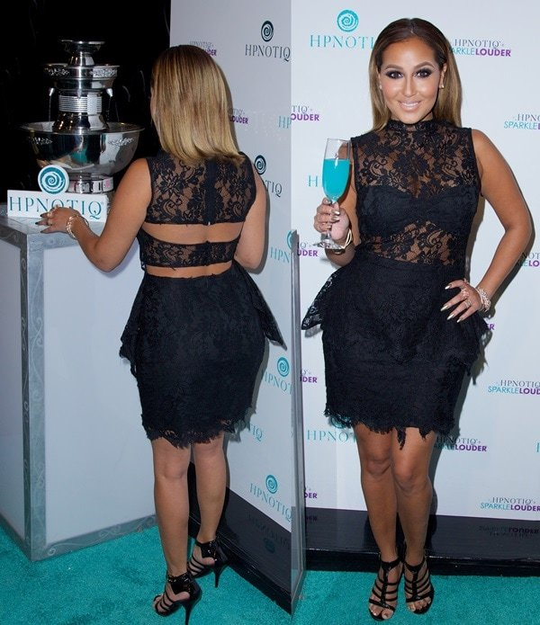 Adrienne styled the sandals with a lace peplum cocktail dress by Jovani featuring a sheer top bodice and a scalloped hemline