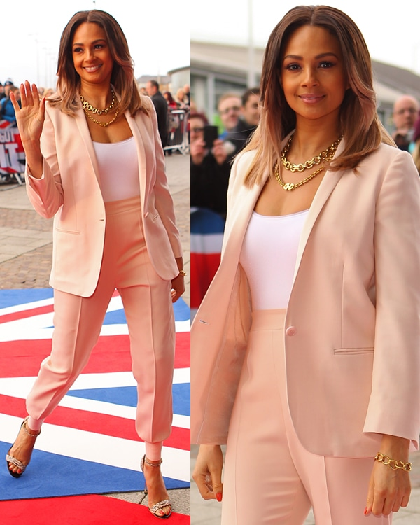 Alesha Dixon wore a Whistles pink coat over a plain white top and a pair of pink trousers
