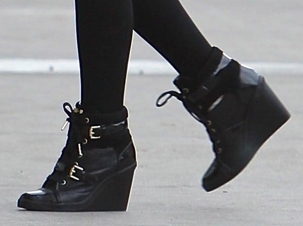 """Ariana Grande wearing MICHAEL Michael Kors """"Skid"""" wedge sneakers"""
