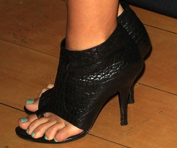Audrina Patridge displays her sexy feet in black booties