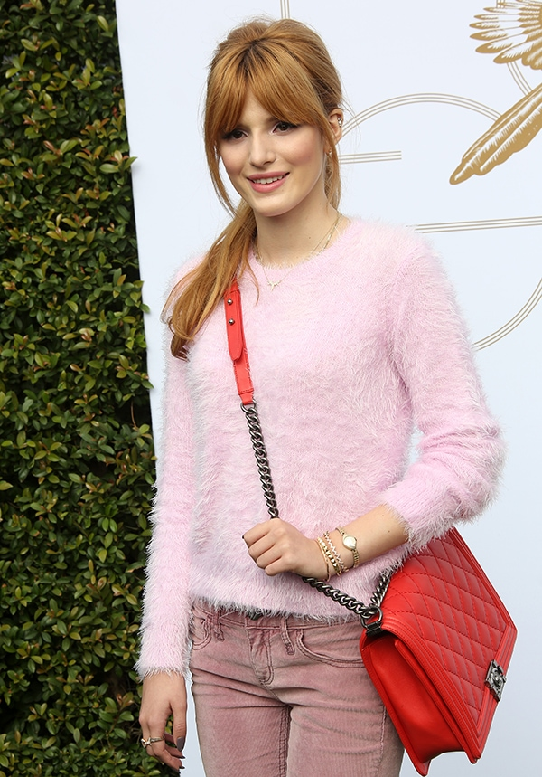 Bella Thorne wore a pink fluffy Topshop sweater and J Brand skinny jeans