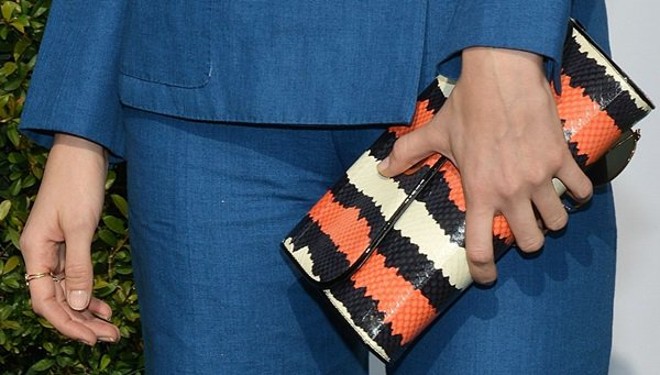 Caitlin Fitzgerald toting a multicolor clutch by Christian Louboutin
