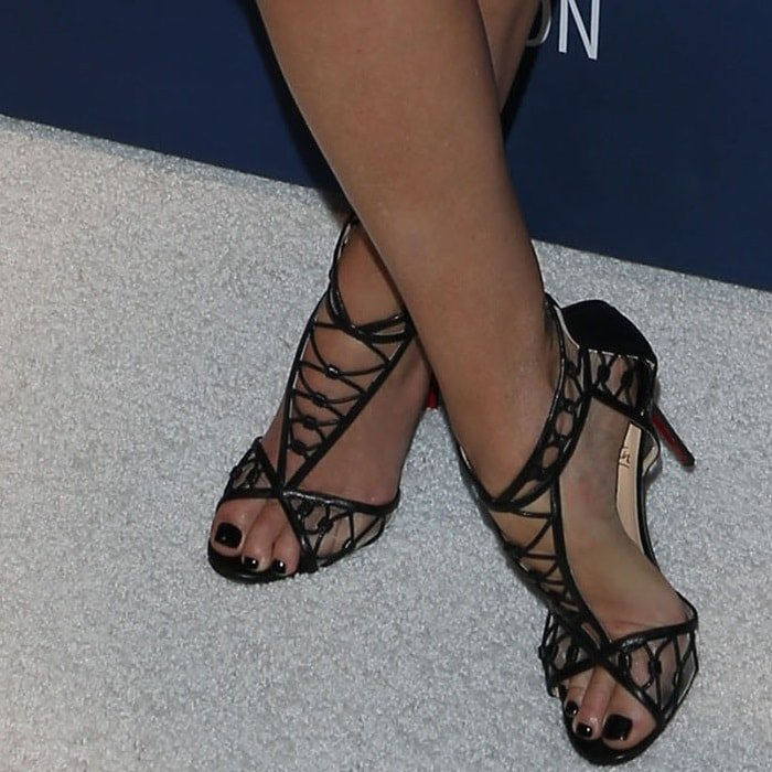 "Charlize Theron wearing Christian Louboutin ""Martha"" sandals"
