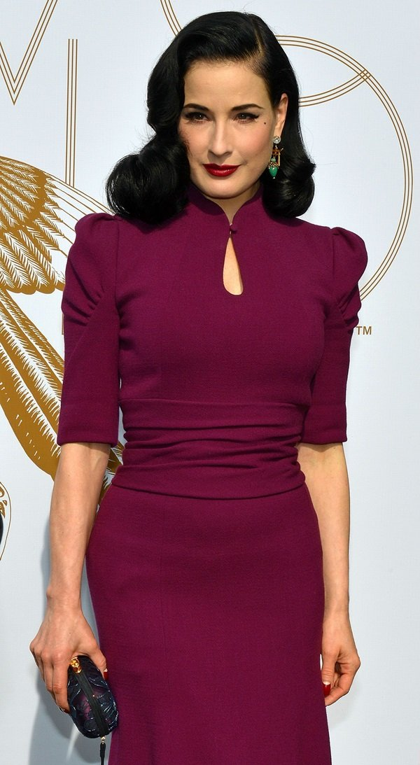 Dita Von Teese styled the dress with a crystal-embellished clutch by Corto Moltedo