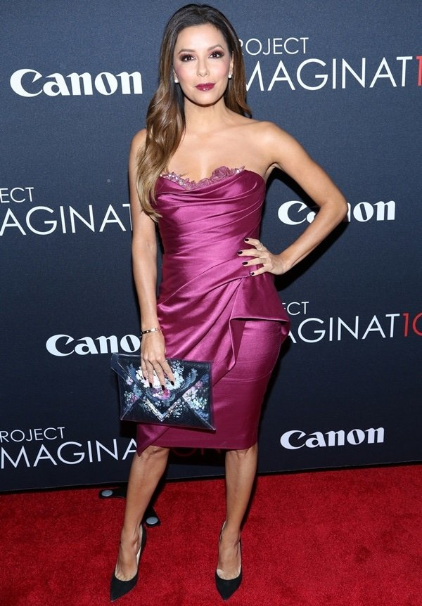 Eva Longoria flaunted her legs in a raspberry strapless cocktail dress by Marchesa