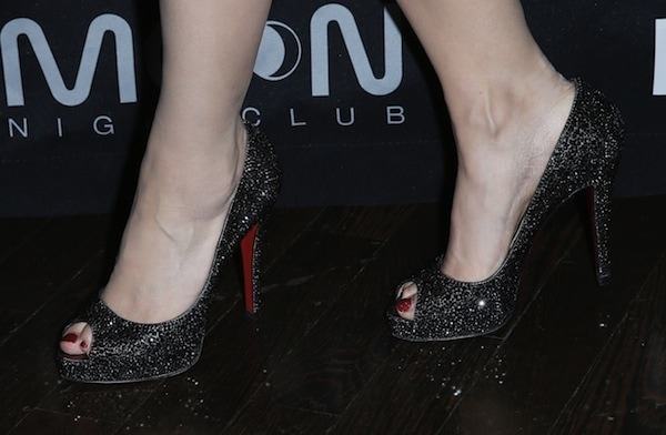 Holly Madison wearing Christian Louboutin 'Very Prive' glitter pumps given by her husband, Pasquale Rotella