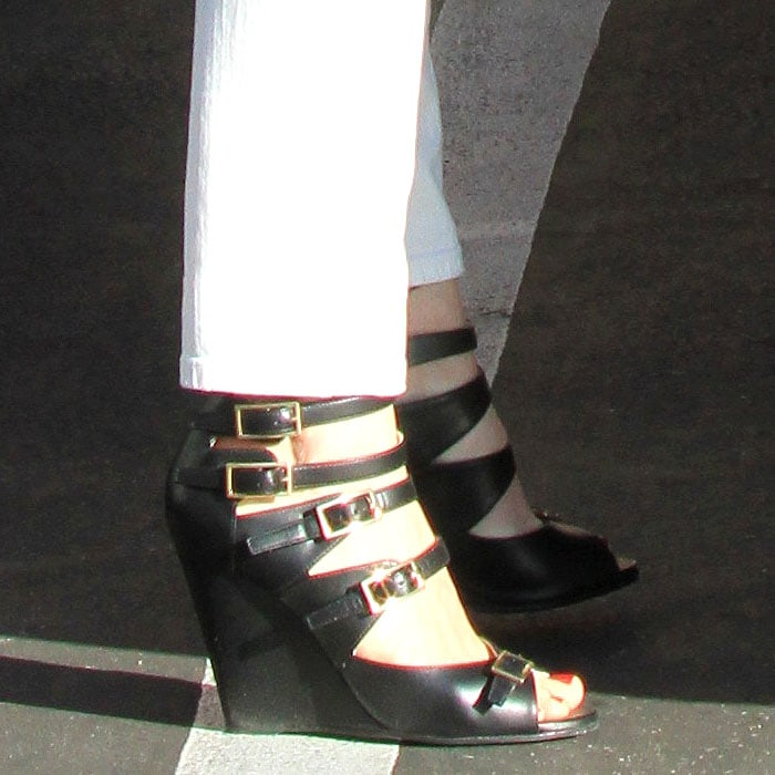 "January Jones wearing multibuckled Arce"" wedge sandals by Chloé"