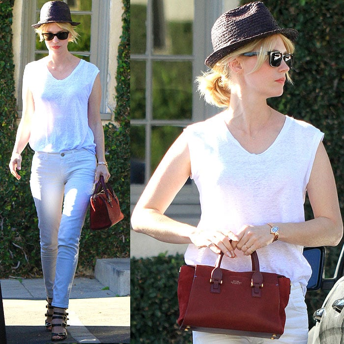 January Jones stepped out in a casual version of an all-white clothes plus black shoes outfit