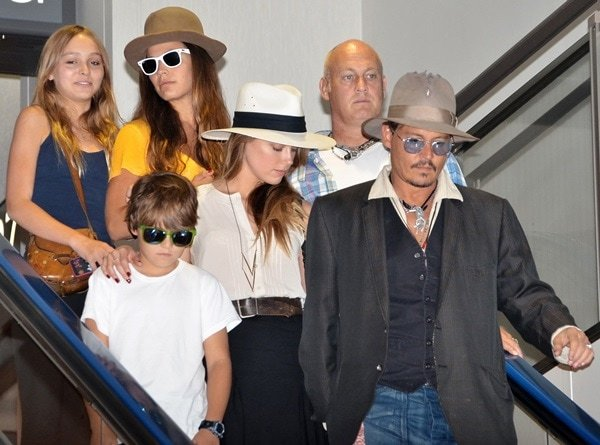Johnny Depp, Jack Depp, Lily-Rose Melody Depp, and Amber Heard at Narita International Airport in Japan on July 18, 2013