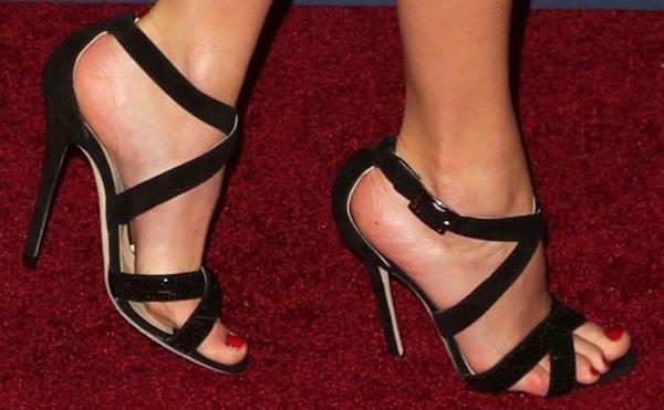"""Taylor Swift wearing black Jimmy Choo """"Lottie"""" suede sandals with crisscross straps"""