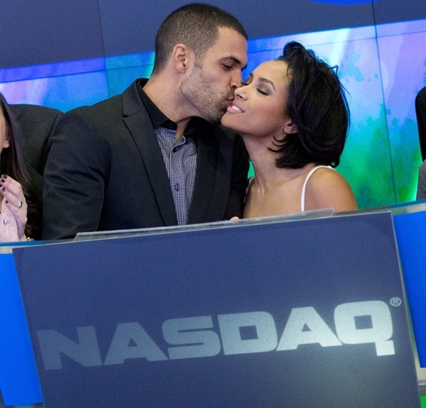 New Year's Eve party hosts Kat Graham and fiancé Cottrell Guidry ringing the closing bell at Nasdaq MarketSite in New York City on December 31, 2013