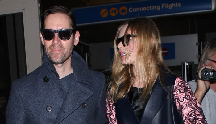 Kate Bosworth wears her hair down as she arrives at Los Angeles International Airport with husband Michael Polish