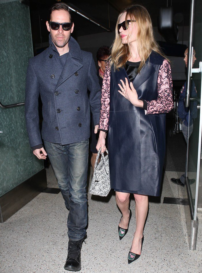 Kate Bosworth wears a lace-detailed blue leather coat as she arrives at LAX with her husband