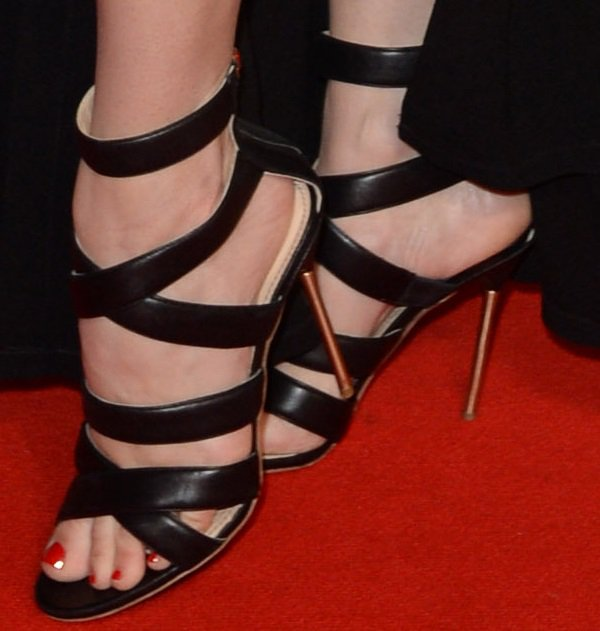 Kelly Brook's hot feet in black strappy Floyd heels