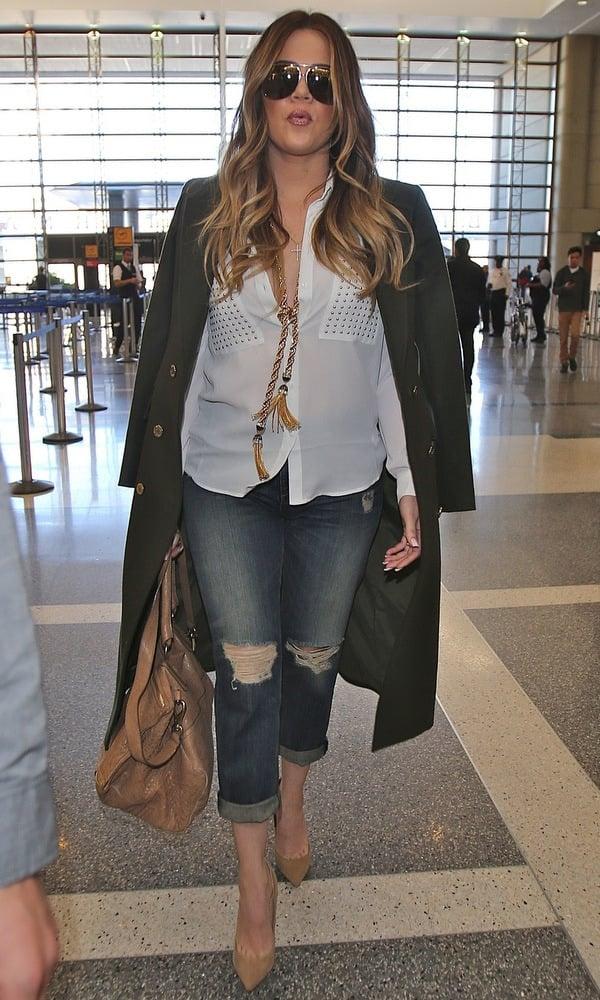 Khloe Kardashian wearing ripped jeans