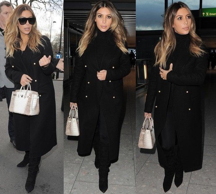 Kim Kardashian covers up in a dark coat as she arrives at Heathrow