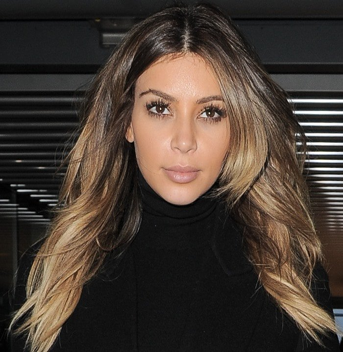 Kim Kardashian wears her hair down during a day out in London