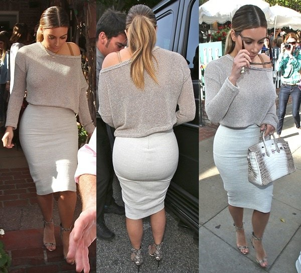 Kim Kardashian flaunts her backside in a tight white pencil skirt paired with a long-sleeved knit top