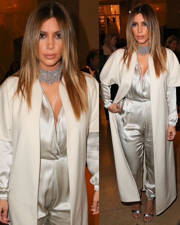 Kim Kardashian wears her hair center-parted as she attends Stephane Rolland's show during Paris Fashion Week Haute Couture Spring/Summer 2014