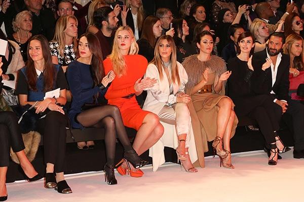 Kim Kardashian sits front row during the Stephanie Rolland show