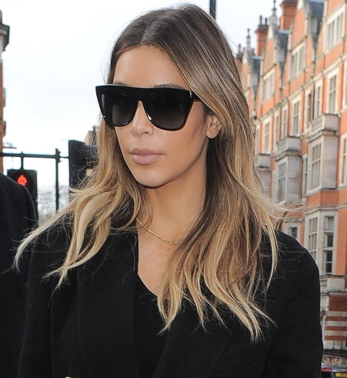 Kim Kardashian hides her eyes behind a dark pair of sunglasses from Celine