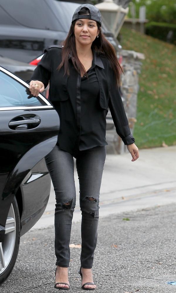 Kourtney Kardashian wearing ripped jeans