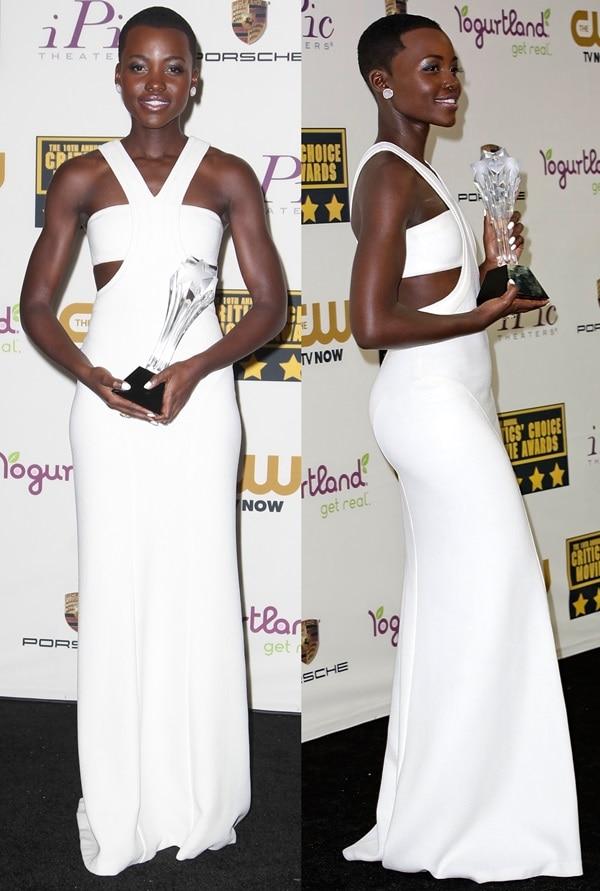 Lupita Nyong'o wearing a sensational custom floor-length ivory silk dress from Calvin Klein