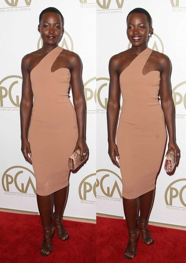 Lupita Nyong'o in a knee-length dress with an asymmetrical shoulder by Stella McCartney at the 25th Annual Producer Guild of America Awards at The Beverly Hilton hotel in Beverly Hills on January 19, 2014