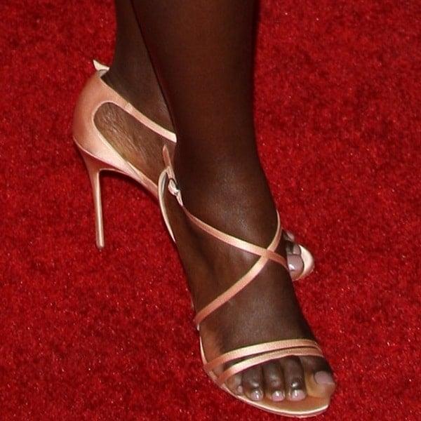 "Lupita Nyong'o showing off her feet in Christian Louboutin ""Gwynitta"" sandals"