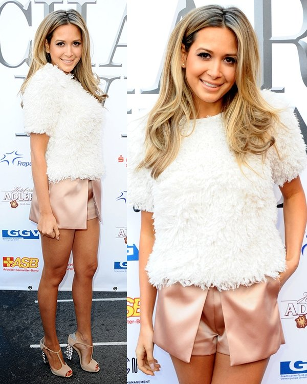 Mandy Capristo sported a furry white top with pink satin skorts
